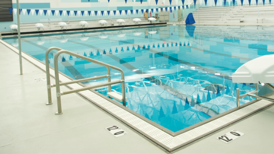 pool gutters vs. skimmers, rec center, high school pool